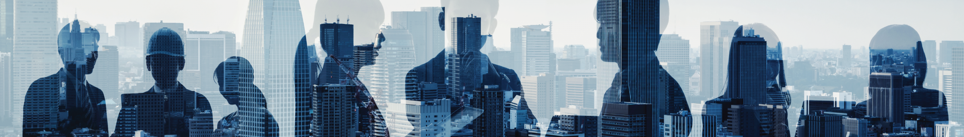 Business people silhouette over background of city skyline